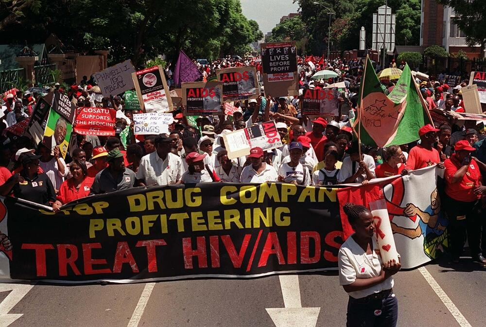 Protesters demonstrate outside Supreme Court in Pretoria, South Africa Monday March 5, 2001