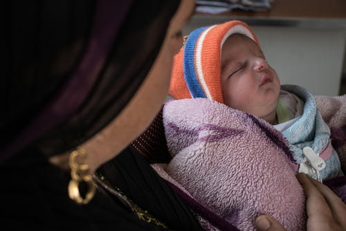 Mohammad, nine days old, with his mother Seva