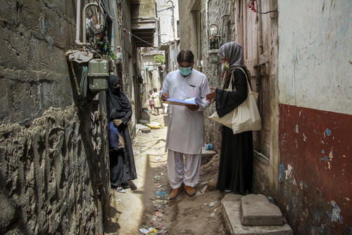 Mask distribution in Machar Colony