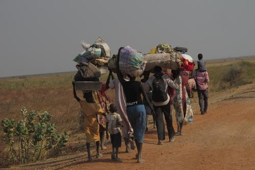 Displaced families walking from Bentiu to Leer, South Sudan.