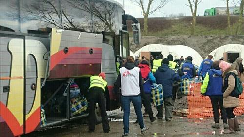 People moving in the new shelters in Grande Synthe