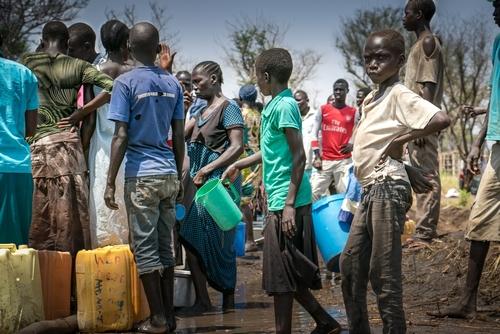 People fetching water in Palorinya refugee camp, Uganda