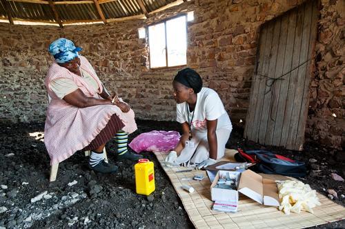 Nelisiwe Ziqugu, Community Health Agent, doing door to door HIV testing. KwaZulu Natal, South Africa.