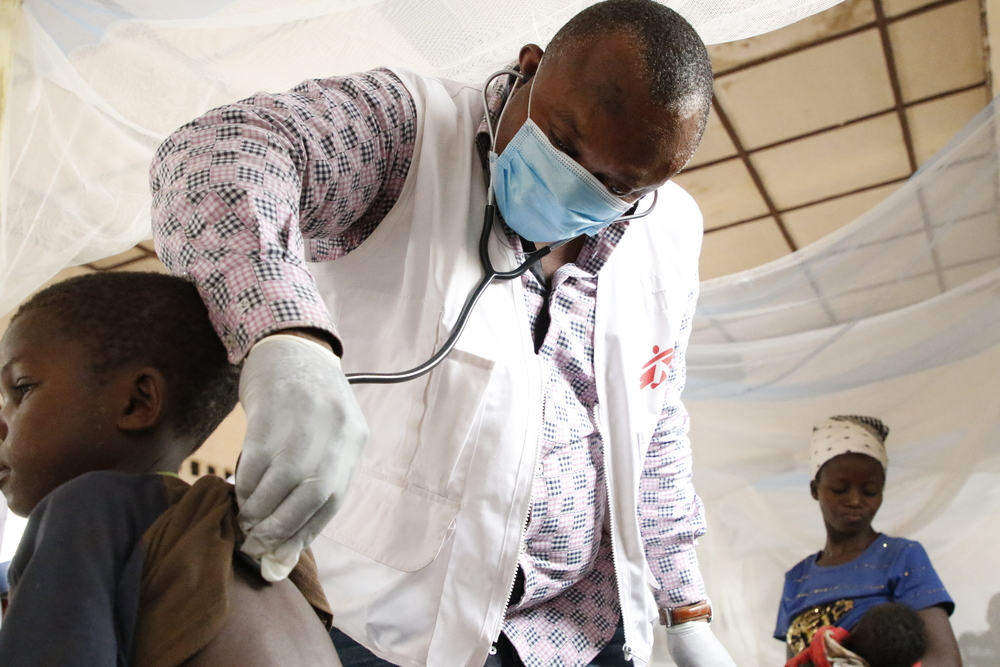 MSF emergency team doctor, examines a child