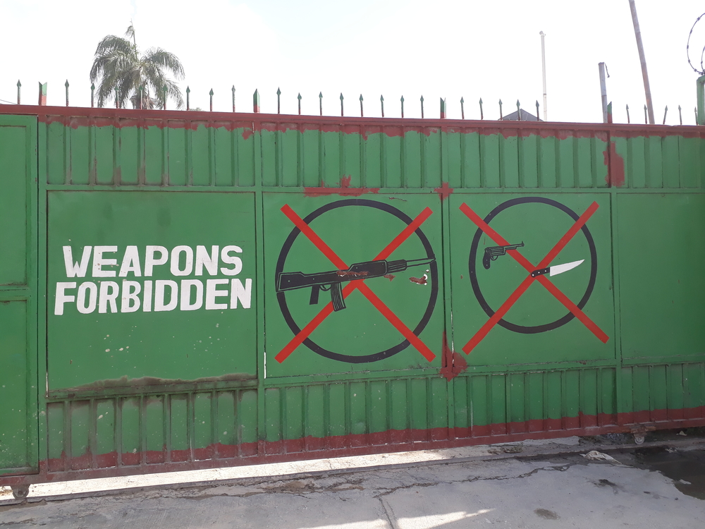 Paintings on the portal with the prohibition of carrying weapons in the emergency center